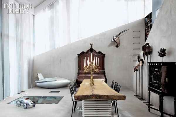 417815-In_the_dining_area_rectangles_of_1_inch_thick_glass_in_the_poured_concrete_floor_allow_light_in_to_the_basement_where_Oomen_s