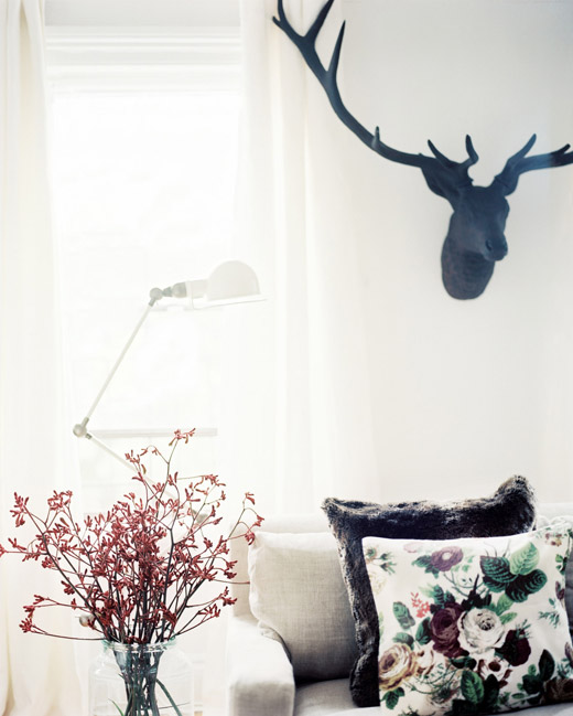 Brooklyn-apt-living-room-white-floral-fur-antlers-floor-lamp-Michelle-Adams-Lonny-Nov12